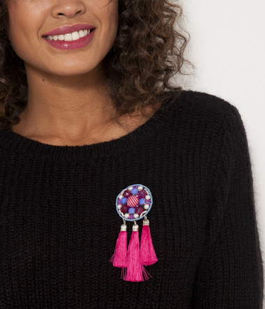 Broche pompons femme
